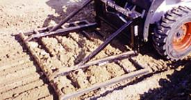 Dirt Worker skid steer attachments.
