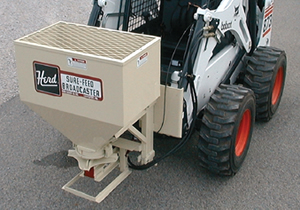 Herd skid steer sand spreaders and salt spreaders.